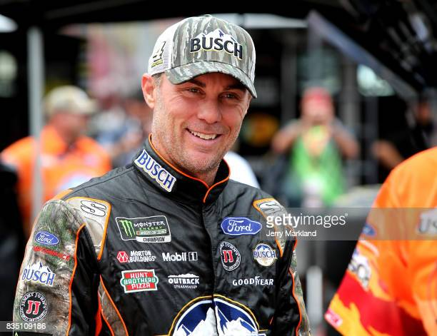Kevin Harvick driver of the Busch Outdoors Ford stands by his car during practice for the Monster Energy NASCAR Cup Series Bass Pro Shops NRA Night...