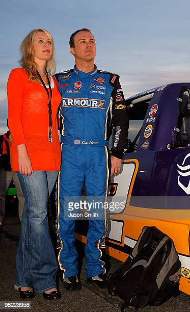 Kevin Harvick, driver of the Charter Chevrolet stands on the grid with wife Delana, during the NASCAR Camping World Truck Series Nashville 200 at...
