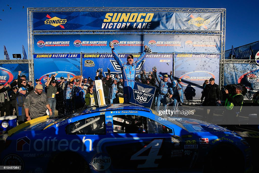 Kevin Harvick, driver of the #4 ditech Chevrolet, celebrates in Victory Lane after winning the NASCAR Sprint Cup Series Bad Boy Off Road 300 at New Hampshire Motor Speedway on September 25, 2016 in Loudon, New Hampshire.