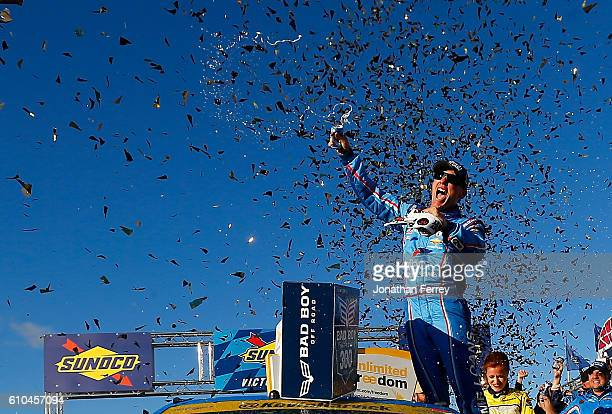 Kevin Harvick driver of the ditech Chevrolet celebrates in Victory Lane after winning the NASCAR Sprint Cup Series Bad Boy Off Road 300 at New...