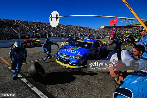 Kevin Harvick driver of the Ditech Chevrolet pits during the NASCAR Sprint Cup Series SYLVANIA 300 at New Hampshire Motor Speedway on September 27...