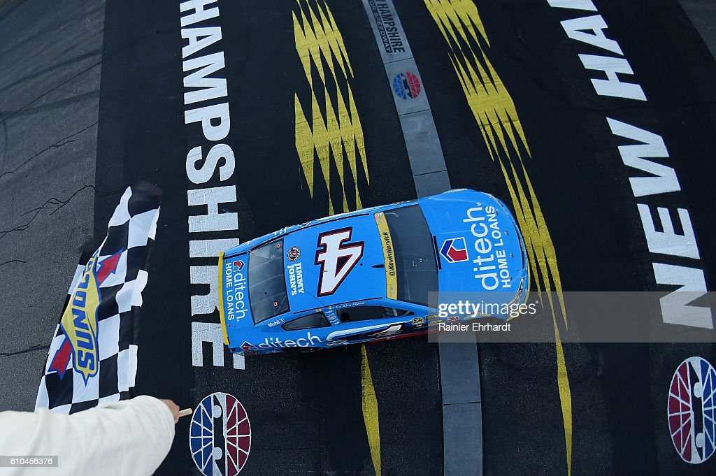 Kevin Harvick, driver of the #4 ditech Chevrolet, takes the checkered flag to win the NASCAR Sprint Cup Series Bad Boy Off Road 300 at New Hampshire Motor Speedway on September 25, 2016 in Loudon, New Hampshire.