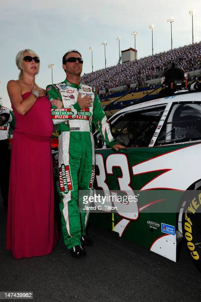 Kevin Harvick, driver of the Hunt Brothers Pizza Chevrolet, and his wife DeLana Harvick stand on the grid during pre-race ceremonies for the NASCAR...