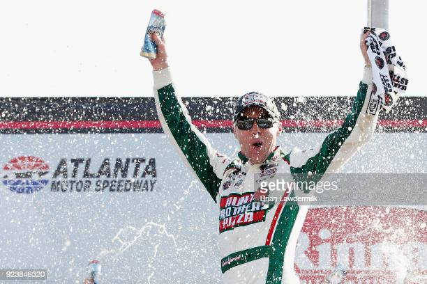 Kevin Harvick driver of the Hunt Brothers Pizza Ford celebrates in Victory Lane after winning the NASCAR Xfinity Series Rinnai 250 at Atlanta Motor...