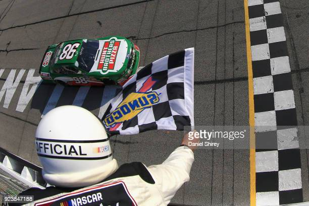 Kevin Harvick driver of the Hunt Brothers Pizza Ford takes the checkered flag to win the NASCAR Xfinity Series Rinnai 250 at Atlanta Motor Speedway...