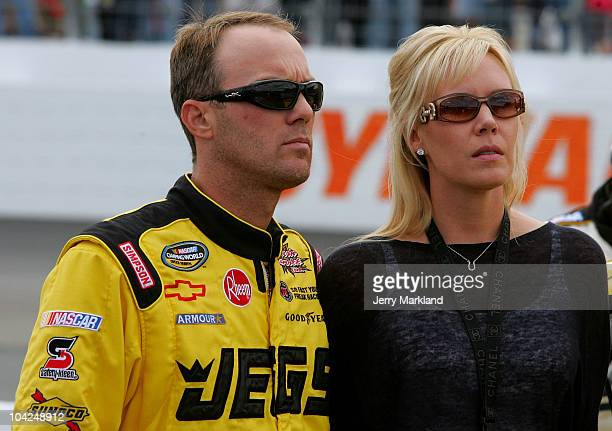 Kevin Harvick, driver of the JEGS.com Chevrolet, stands on the grid with his wife DeLana prior to the start of the NASCAR Camping World Truck Series...