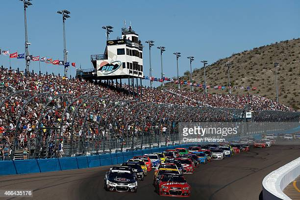 Kevin Harvick driver of the Jimmy John's/ Budweiser Chevrolet and Kurt Busch driver of the Haas Automation Chevrolet lead the field to a restart...