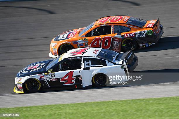 Kevin Harvick driver of the Jimmy John's / Budweiser Chevrolet and Landon Cassill driver of the CRC Knock'er Loose Chevrolet race during the NASCAR...
