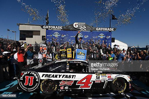 Kevin Harvick driver of the Jimmy John's/ Budweiser Chevrolet celebrates in victory lane after winning the NASCAR Sprint Cup Series CampingWorldcom...
