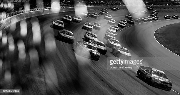 Kevin Harvick driver of the Jimmy John's / Budweiser Chevrolet leads a pack of cars during the NASCAR Sprint Cup Series myAFibRiskcom 400 at...