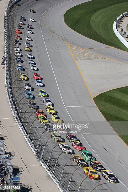 Kevin Harvick driver of the Jimmy John's / Budweiser Chevrolet leads the field during the NASCAR Sprint Cup Series myAFibRiskcom 400 at Chicagoland...
