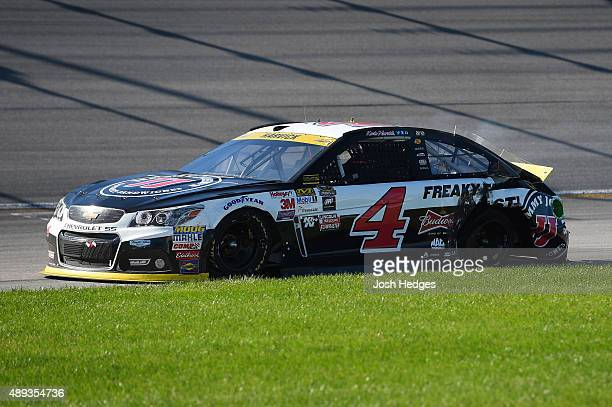 Kevin Harvick driver of the Jimmy John's / Budweiser Chevrolet sits in the grass after an incident on the track during the NASCAR Sprint Cup Series...