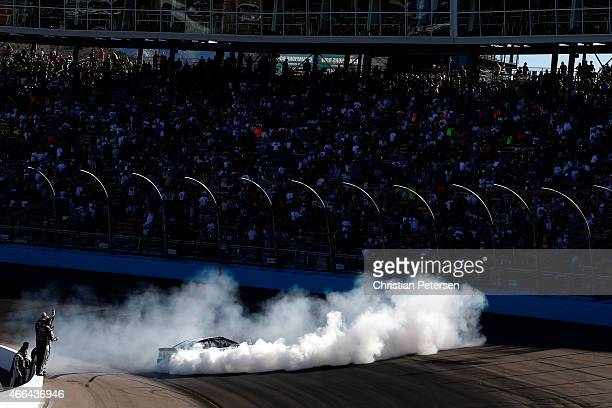 Kevin Harvick driver of the Jimmy John's/ Budweiser Chevrolet celebrates with a burnout after winning after winning the NASCAR Sprint Cup Series...