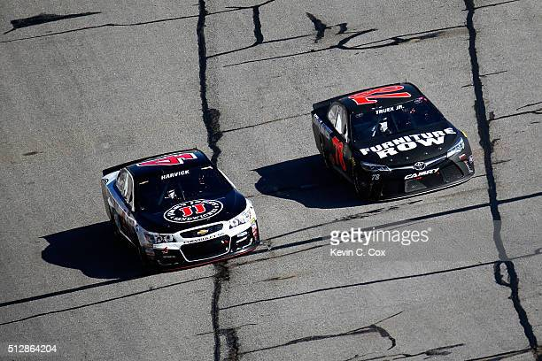 Kevin Harvick driver of the Jimmy John's Chevrolet and Martin Truex Jr driver of the Furniture Row Toyota race during the NASCAR Sprint Cup Series...