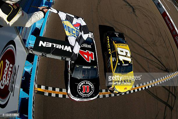 Kevin Harvick driver of the Jimmy John's Chevrolet beats Carl Edwards driver of the Stanley Toyota to the checkered flag to win the NASCAR Sprint Cup...