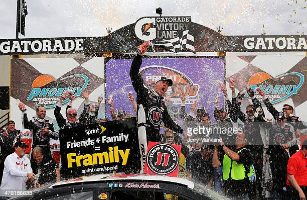 Kevin Harvick driver of the Jimmy John's Chevrolet celebrates in Victory Lane after winning the NASCAR Sprint Cup Series The Profit On CNBC 500 at...