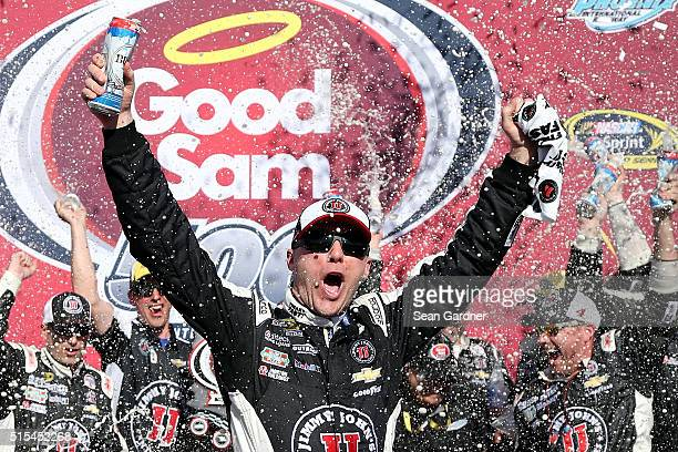 Kevin Harvick driver of the Jimmy John's Chevrolet celebrates in Victory Lane after winning the NASCAR Sprint Cup Series Good Sam 500 at Phoenix...