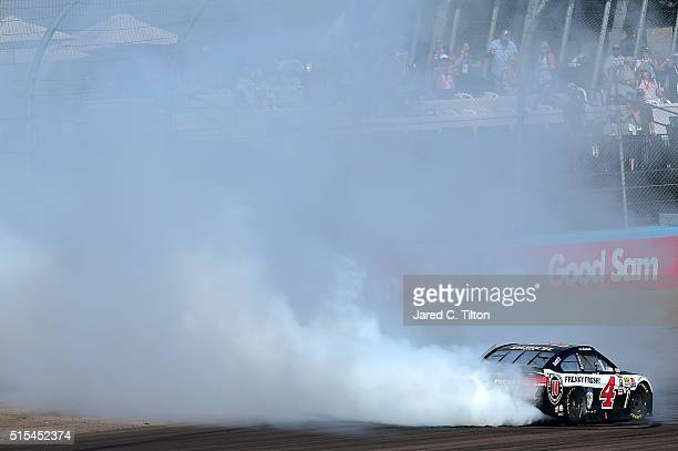 Kevin Harvick driver of the Jimmy John's Chevrolet celebrates with a burnout after winning the NASCAR Sprint Cup Series Good Sam 500 at Phoenix...