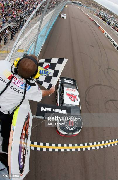 Kevin Harvick driver of the Jimmy John's Chevrolet comes to the finish line to win the NASCAR Sprint Cup Series The Profit On CNBC 500 at Phoenix...
