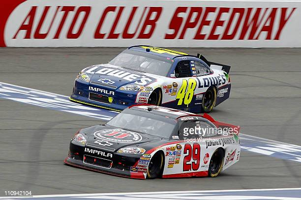 Kevin Harvick driver of the Jimmy John's Chevrolet leads Jimmie Johnson driver of the Lowe's Chevrolet to the finish line to win the NASCAR Sprint...