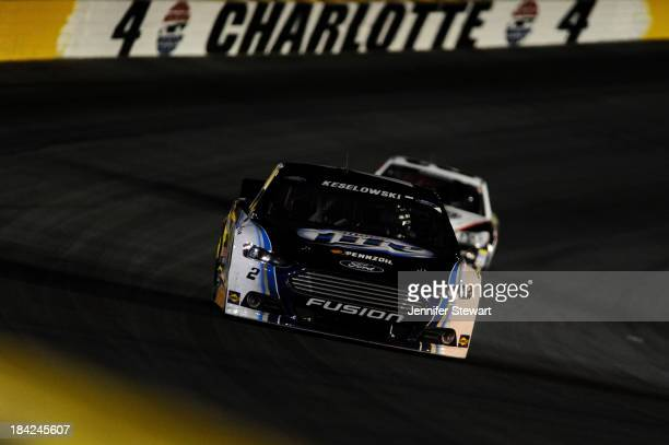 Kevin Harvick driver of the Jimmy John's Chevrolet leads Kevin Harvick driver of the Jimmy John's Chevrolet during the NASCAR Sprint Cup Series Bank...