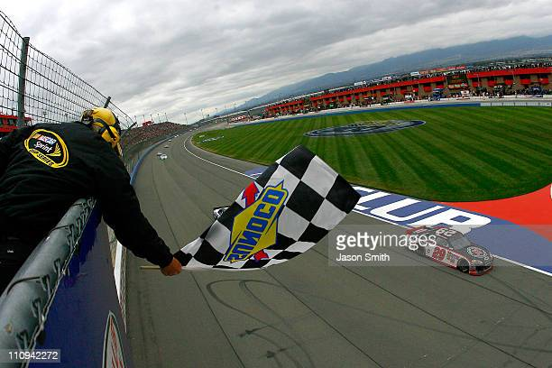 Kevin Harvick driver of the Jimmy John's Chevrolet takes the checkered flag to win the NASCAR Sprint Cup Series Auto Club 400 at Auto Club Speedway...