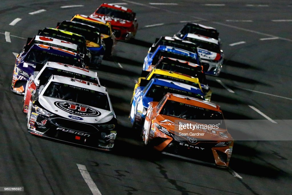 Kevin Harvick, driver of the #4 Jimmy John's Ford, and Daniel Suarez, driver of the #19 ARRIS Toyota, lead the field during the Monster Energy NASCAR Cup Series All-Star Race at Charlotte Motor Speedway on May 19, 2018 in Charlotte, North Carolina.