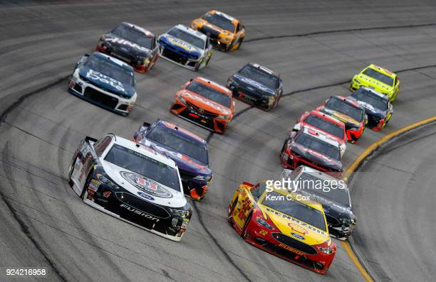 Kevin Harvick driver of the Jimmy John's Ford and Joey Logano driver of the Shell Pennzoil Ford lead a pack of cars during the Monster Energy NASCAR...