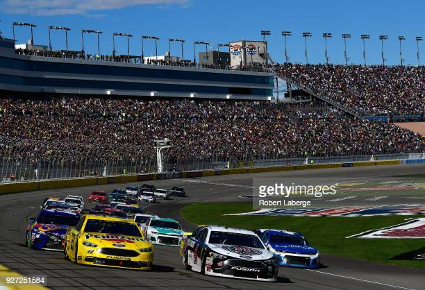 Kevin Harvick driver of the Jimmy John's Ford and Joey Logano driver of the Pennzoil Ford lead the field during the Monster Energy NASCAR Cup Series...