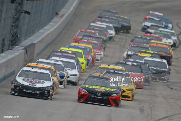 Kevin Harvick driver of the Jimmy John's Ford and Martin Truex Jr driver of the 5hour ENERGY/Bass Pro Shops Toyota take the green flag to start the...