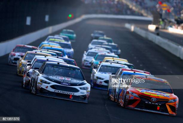 Kevin Harvick driver of the Jimmy John's Ford and Matt Kenseth driver of the Tide Pods Toyota restart the field during the Monster Energy NASCAR Cup...