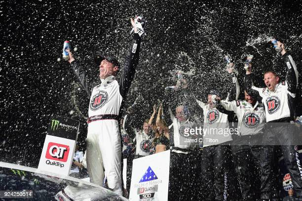 Kevin Harvick driver of the Jimmy John's Ford celebrates in Victory Lane after winning the Monster Energy NASCAR Cup Series Folds of Honor QuikTrip...
