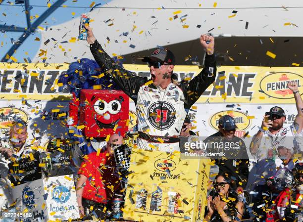 Kevin Harvick driver of the Jimmy John's Ford celebrates in victory lane after winning the Monster Energy NASCAR Cup Series Pennzoil 400 presented by...