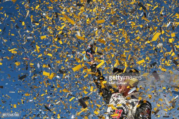 Kevin Harvick, driver of the Jimmy John's Ford, celebrates in victory lane after winning the Monster Energy NASCAR Cup Series Pennzoil 400 presented...