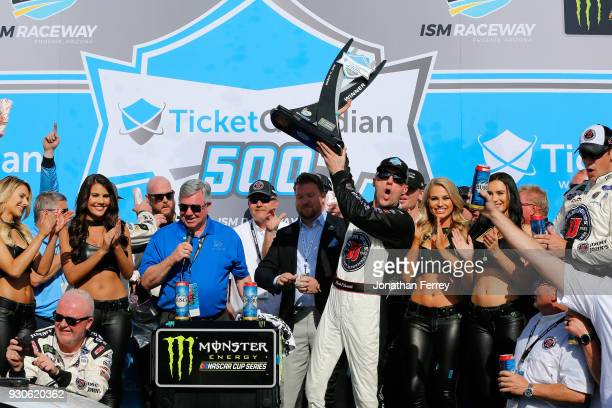 Kevin Harvick driver of the Jimmy John's Ford celebrates in Victory Lane after winning the Monster Energy NASCAR Cup Series TicketGuardian 500 at ISM...