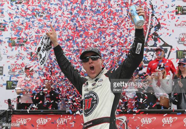 Kevin Harvick driver of the Jimmy John's Ford celebrates in victory lane after winning the Monster Energy NASCAR Cup Series AAA 400 Drive for Autism...