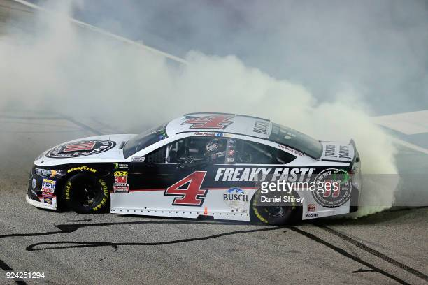 Kevin Harvick driver of the Jimmy John's Ford celebrates with a burnout after winning the Monster Energy NASCAR Cup Series Folds of Honor QuikTrip...
