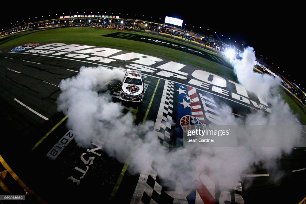 Kevin Harvick, driver of the #4 Jimmy John's Ford, celebrates with a burnout after winning the Monster Energy NASCAR Cup Series All-Star Race at Charlotte Motor Speedway on May 19, 2018 in Charlotte, North Carolina.