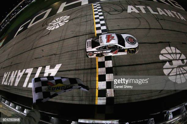 Kevin Harvick driver of the Jimmy John's Ford crosses the finish line to win the Monster Energy NASCAR Cup Series Folds of Honor QuikTrip 500 at...