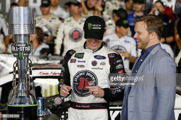 Kevin Harvick driver of the Jimmy John's Ford is awarded a ring by Bruton Smith in Victory Lane after winning the Monster Energy NASCAR Cup Series...