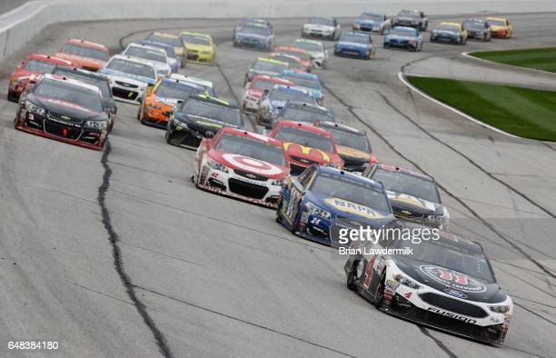 Kevin Harvick driver of the Jimmy John's Ford leads Chase Elliott driver of the NAPA Chevrolet during the Monster Energy NASCAR Cup Series Folds Of...