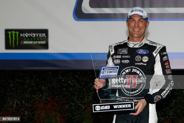 Kevin Harvick, driver of the Jimmy John's Ford, poses with the track pole award after posting the fastest lap during qualifying for the Monster...