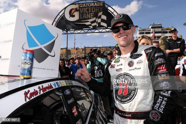 Kevin Harvick driver of the Jimmy John's Ford poses with the Winner's Decal in Victory Lane after winning the Monster Energy NASCAR Cup Series...