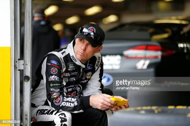 Kevin Harvick driver of the Jimmy John's Ford stands in the garage area during practice for the Monster Energy NASCAR Cup Series 59th Annual DAYTONA...