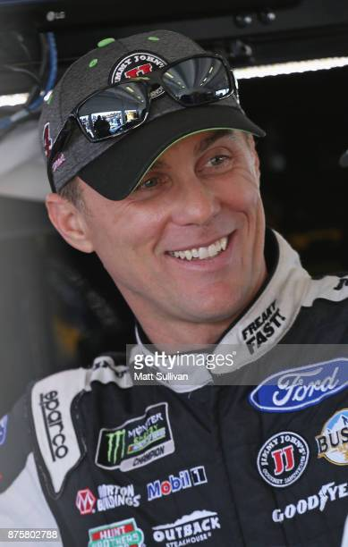 Kevin Harvick driver of the Jimmy John's Ford stands in the garage area during practice for the Monster Energy NASCAR Cup Series Championship Ford...