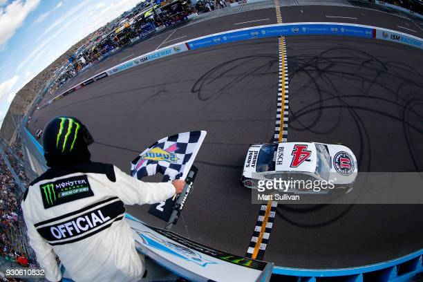 Kevin Harvick driver of the Jimmy John's Ford takes the checkered flag to win the Monster Energy NASCAR Cup Series TicketGuardian 500 at ISM Raceway...