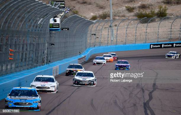Kevin Harvick driver of the Jimmy John's Ford takes the checkered flag to win during the Monster Energy NASCAR Cup Series TicketGuardian 500 at ISM...