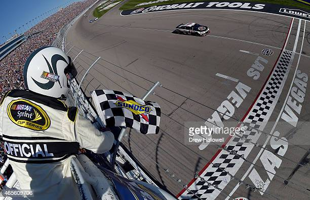 Kevin Harvick driver of the Jimmy John's/Budweiser Chevrolet approaches the checkered flag to win the NASCAR Sprint Cup Series Kobalt 400 at Las...