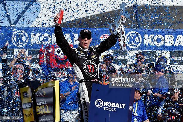 Kevin Harvick driver of the Jimmy John's/Budweiser Chevrolet celebrates in Victory Lane after winning the NASCAR Sprint Cup Series Kobalt 400 at Las...