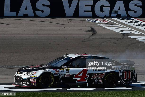 Kevin Harvick driver of the Jimmy John's/Budweiser Chevrolet celebrates after winning the the NASCAR Sprint Cup Series Kobalt 400 at Las Vegas Motor...